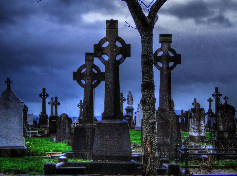 2. spooky killarney Celtic Crosses at Night